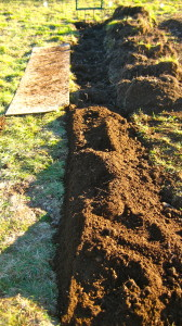 The reserved loose soil is then placed on top of the new deep bed